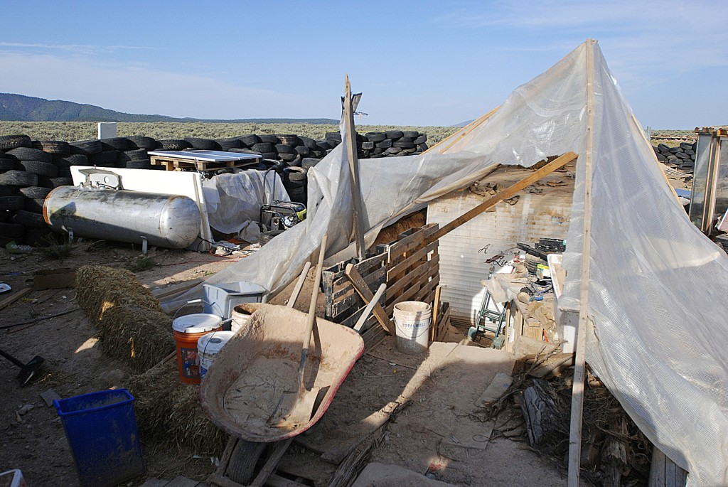 FILE - This Aug. 10, 2018 file photo shows various items littering a squalid makeshift living compound in Amalia, N.M. Five former residents of a New