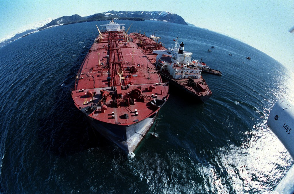 FILE - In this April 4, 1989, file photo, the grounded tanker Exxon Valdez, left, unloads oil onto a smaller tanker, San Francisco, as efforts to refl...