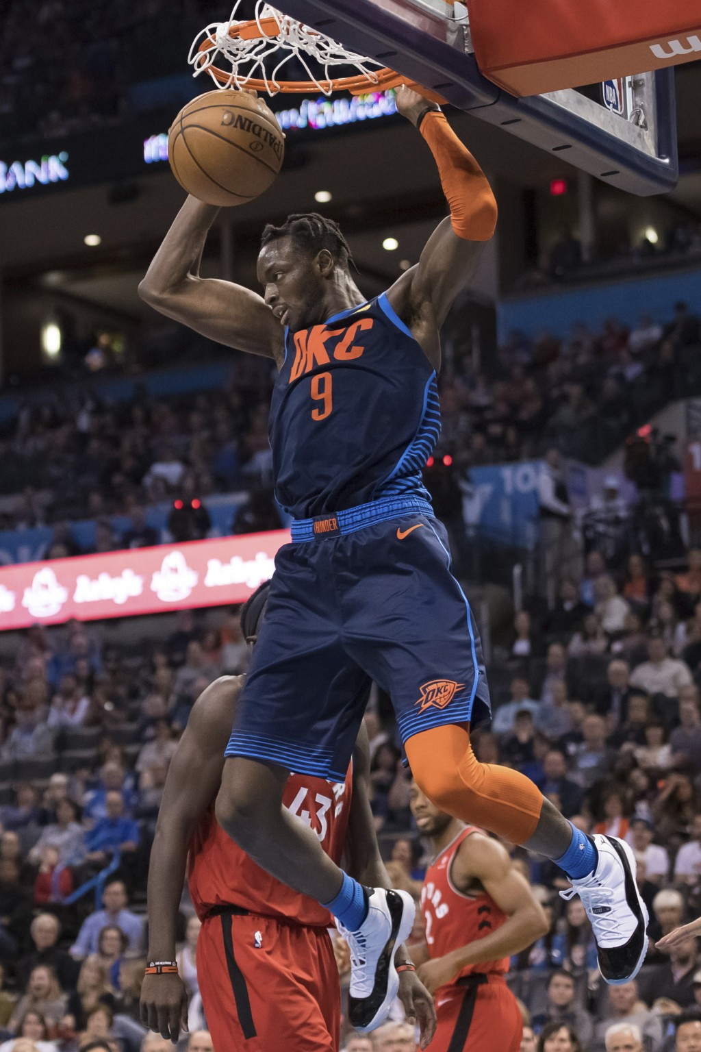 Oklahoma City Thunder forward Jerami Grant dunks against the Toronto Raptors during the second half of an NBA basketball game Wednesday, March 20, 201...