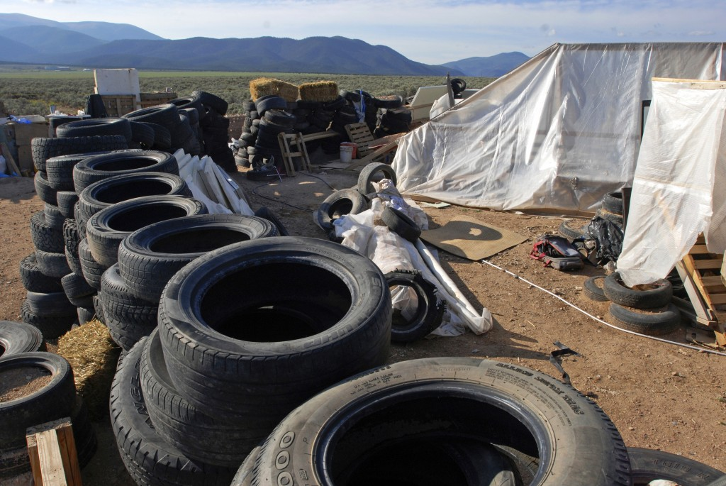 FILE - This Aug. 10, 2018 file photo shows a makeshift living compound in Amalia, N.M. Five former residents of a New Mexico compound where authoritie