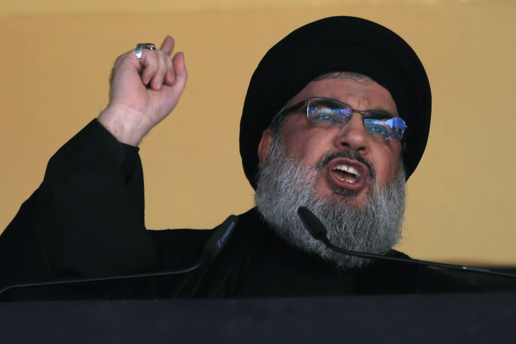 FILE - In this Oct. 24, 2015 file photo, Hezbollah leader Sheik Hassan Nasrallah addresses a crowd during the holy day of Ashoura, in a southern subur...