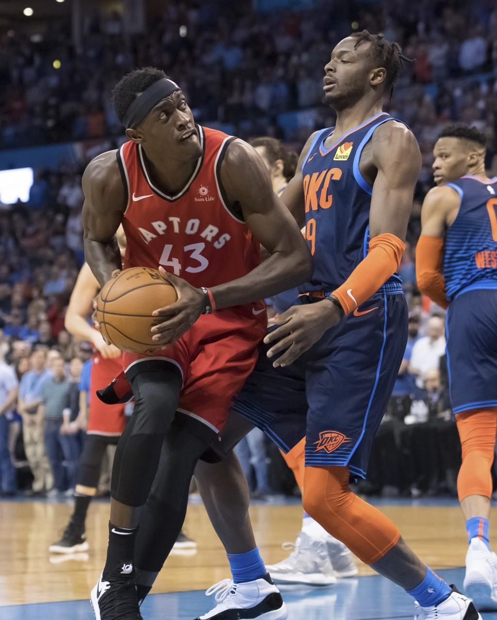 Toronto Raptors forward Pascal Siakam (43) bumps against Oklahoma City Thunder forward Jerami Grant (9) during the first half of an NBA basketball gam...