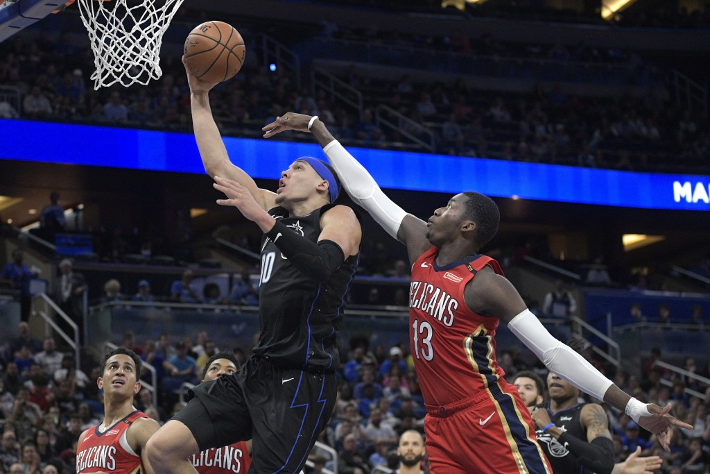 Orlando Magic forward Aaron Gordon (00) goes up for a shot in front of New Orleans Pelicans forward Cheick Diallo (13) during the second half of an NB...