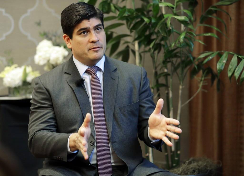 In this Monday, March 11, 2019, photo, Costa Rican president Carlos Alvarado gestures as he takes part in an interview with The Associated Press in Se