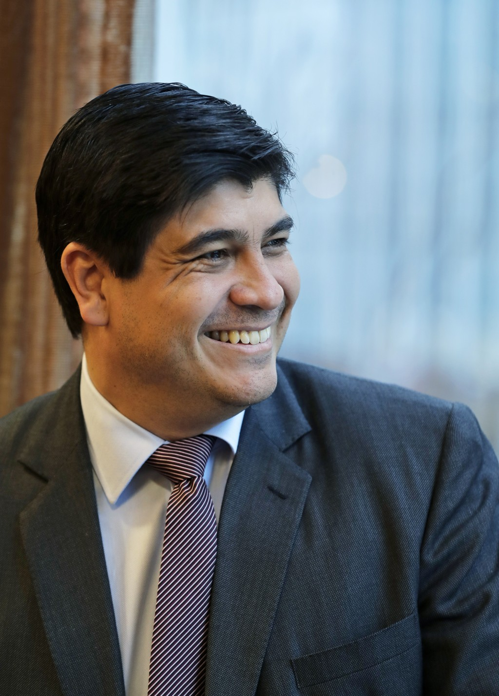 In this Monday, March 11, 2019, photo, Costa Rican president Carlos Alvarado smiles as he poses for a photo before an interview with The Associated Pr