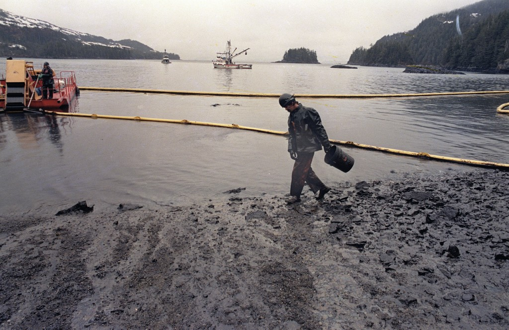 FILE - In this April 17, 1989, file photo, a worker makes his way across the polluted shore of Block Island, Alaska, as efforts are underway to test t...