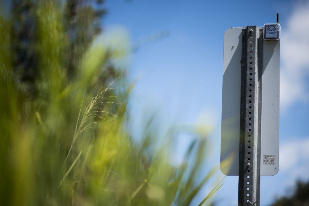 This March 13, 2019 photo shows a transmitter that is part of a system that provides a low-frequency Wi-Fi connection, on the back of a traffic sign,
