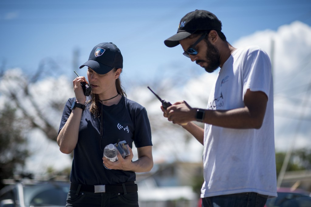 In this March 13, 2019 photo, self-taught Puerto Rican tech developer Pedro Cruz, right, and Maria M., test the Clusterduck system, that provides a lo