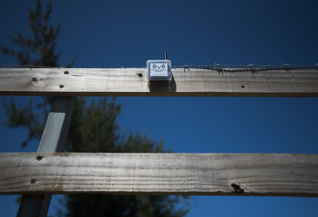 This March 13, 2019 photo shows a transmitter that is part of a system that provides a low-frequency Wi-Fi connection, affixed to the slat of a wooden