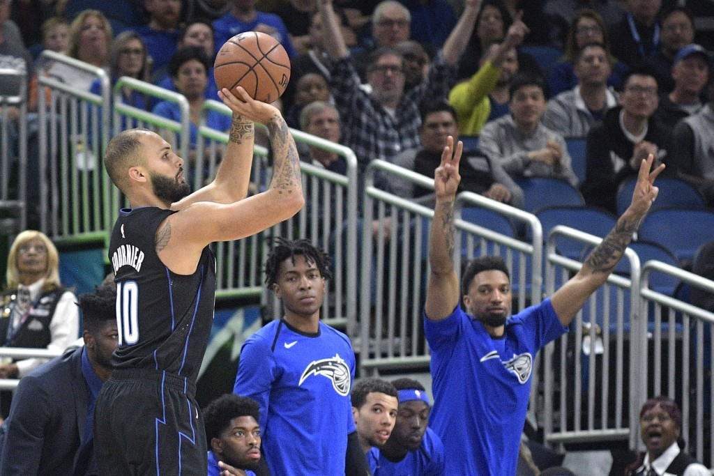 Orlando Magic guard Evan Fournier (10) goes up for a 3-pointer during the first half of the team's NBA basketball game against the New Orleans Pelican...