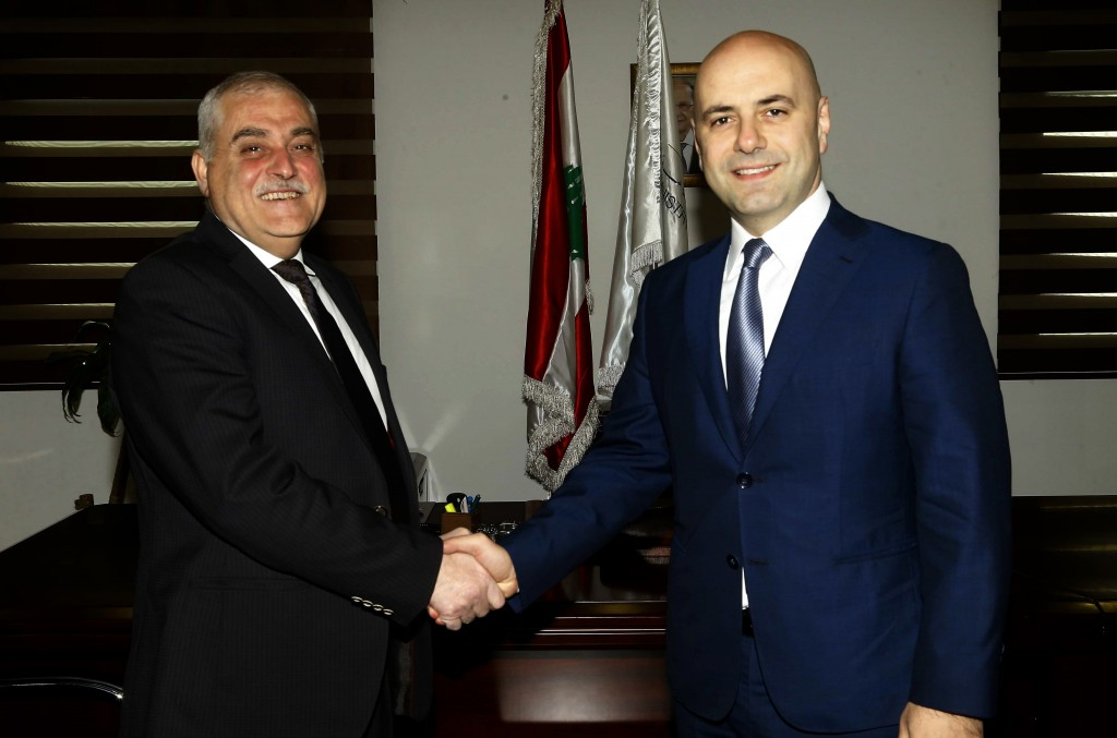 FILE - In this Feb. 15, 2019 file photo, released by the Lebanese Government, Lebanese Health Minister Jamil Jabak, who was chosen by Hezbollah, left,