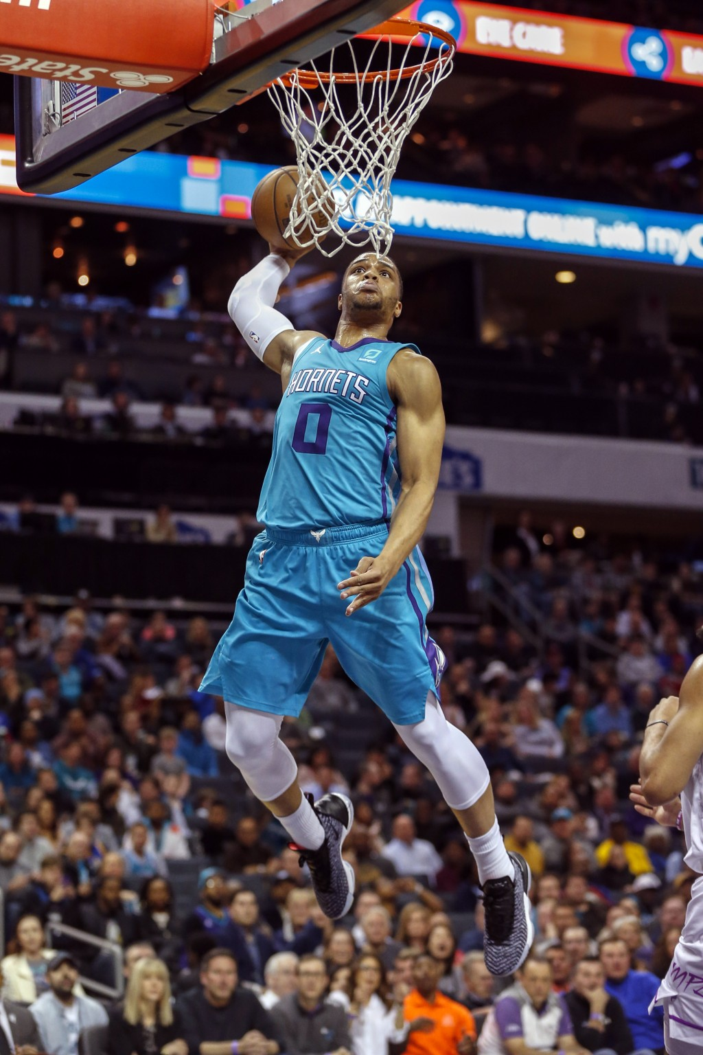 Charlotte Hornets forward Miles Bridges (0) dunks against the Minnesota Timberwolves in the first half of an NBA basketball game in Charlotte, N.C., T