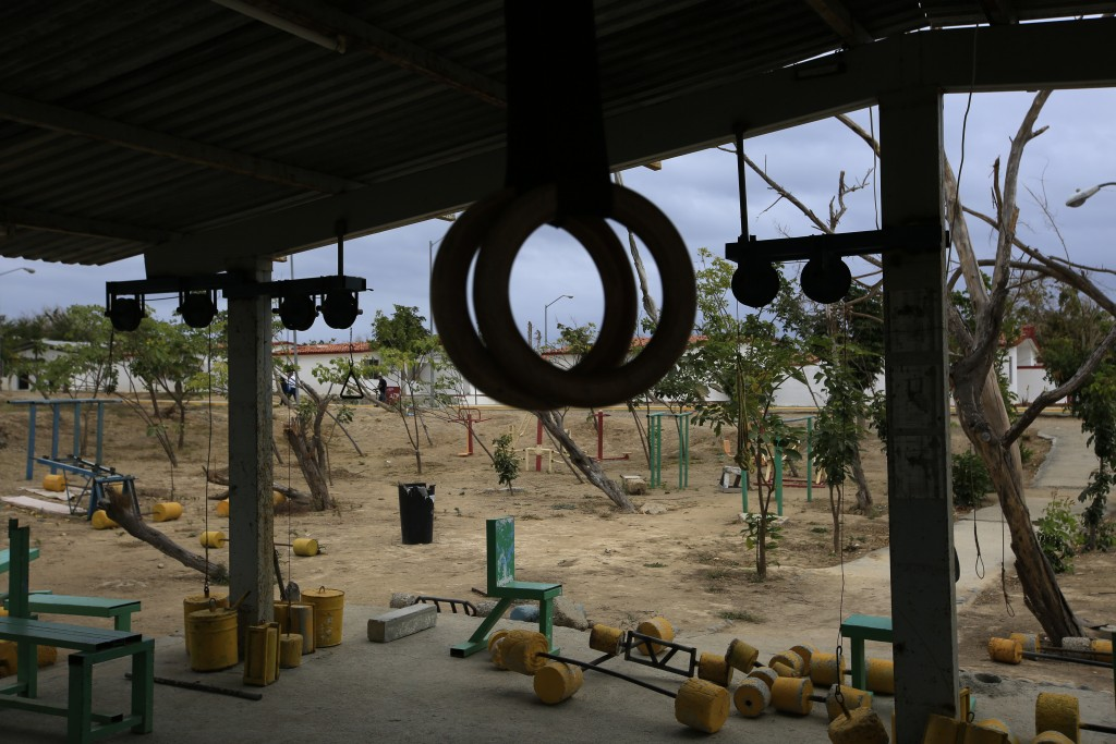 Weights made from cement lie scattered on the ground at an outdoor gym once used by prisoners at the now closed Morelos detention center during a medi