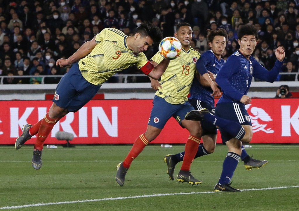 Colombia's Radamel Falcao, left, tries to score a goal during a friendly soccer match between Japan and Colombia in Yokohama, Japan, Friday, March 22,...