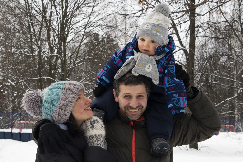 In this photo taken on Saturday, Feb. 16, 2019, Ilya Zhegulev, a journalist for the Latvia-based Russian website Meduza, his son Ivan and his wife Kat...
