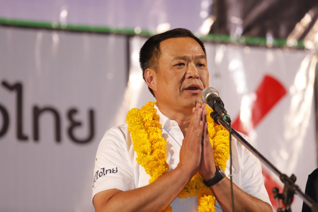 In this March 14, 2019, photo, the leader of Bhumjai Thai Party and candidate for prime minister Anutin Charnvirakul gives the traditional greeting or