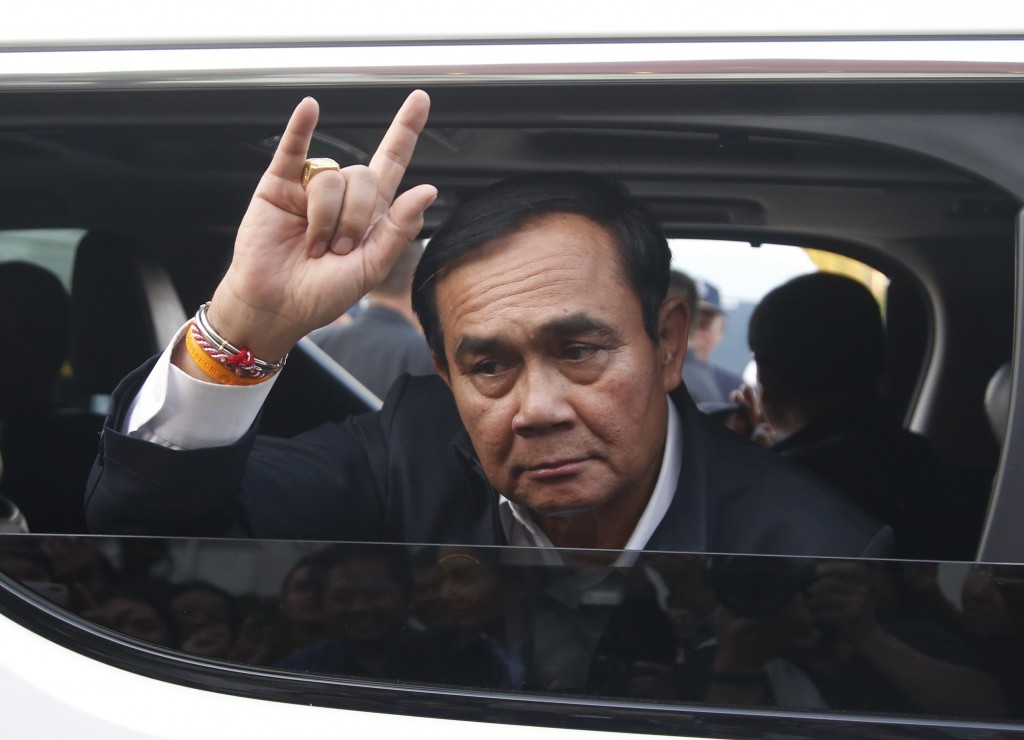 In this March 13, 2019, photo, Thai Prime Minister Prayuth Chan-ocha and candidate for the same position, gives the love sign after attending a govern
