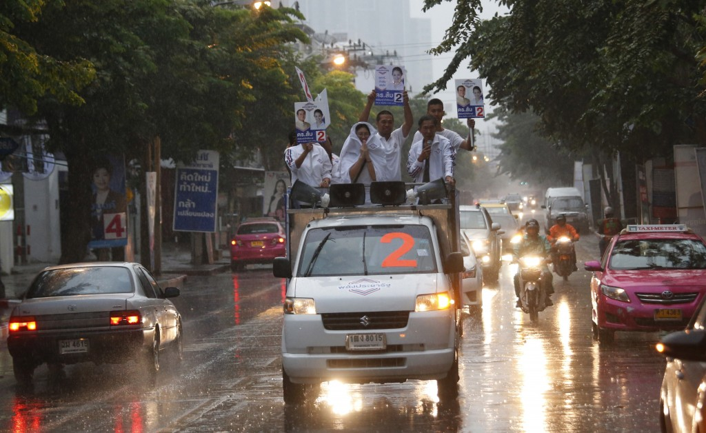 In this  March 17, 2019, photo, the Thai Palang Pracharat Party members parade through a town on a truck in Bangkok, Thailand. Thailand heads to the p