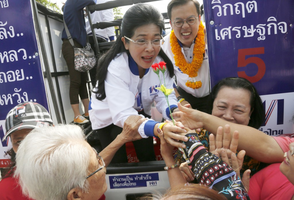 In this March 21, 2019, photo, the leader of Pheu Thai Party and candidate for prime minister Sudarat Keyuraphan, center, meets supporters during an e