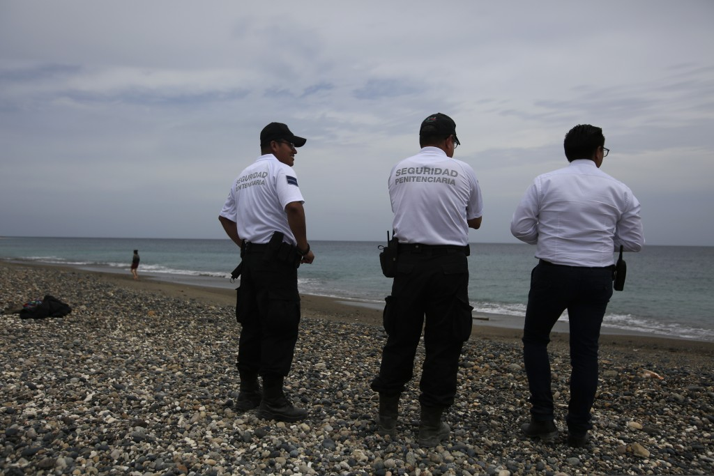 Prison guards stand on the shore of the Pacific Ocean during a media tour of the now closed Islas Marias penal colony, Mexico, Saturday, March 16, 201