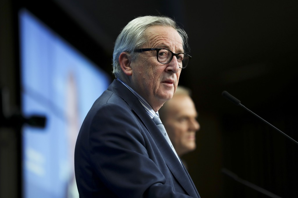 European Commission President Jean-Claude Juncker, left, and European Council President Donald Tusk participate in a media conference at the conclusio