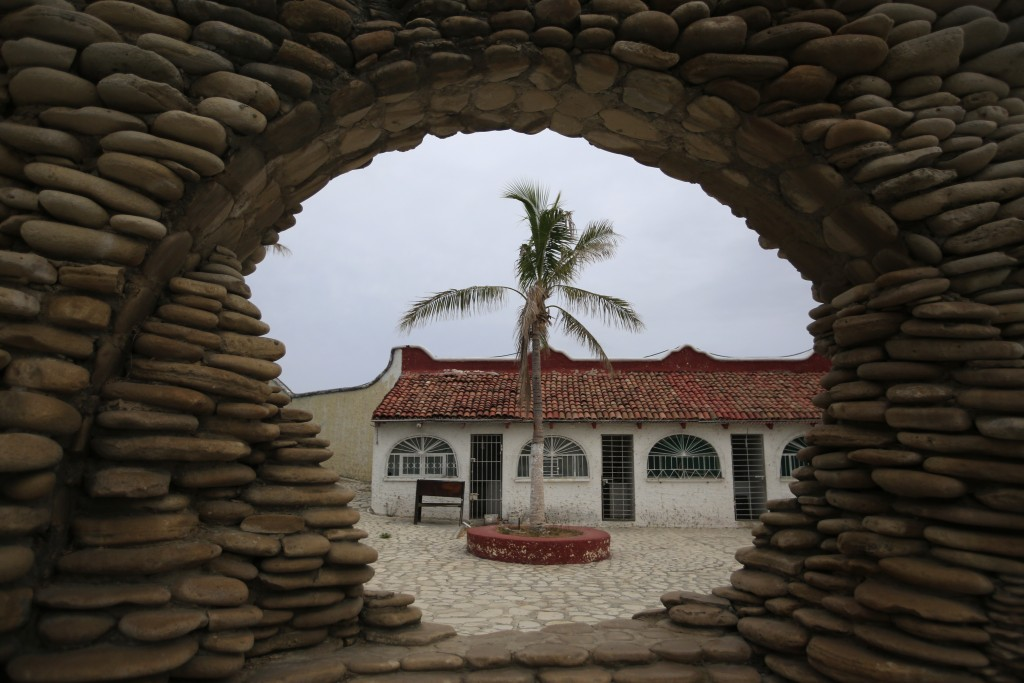 A former cell block is framed by a stone monument in Puerto Balleto, during a media tour of the now closed Islas Marias penal colony located off Mexic