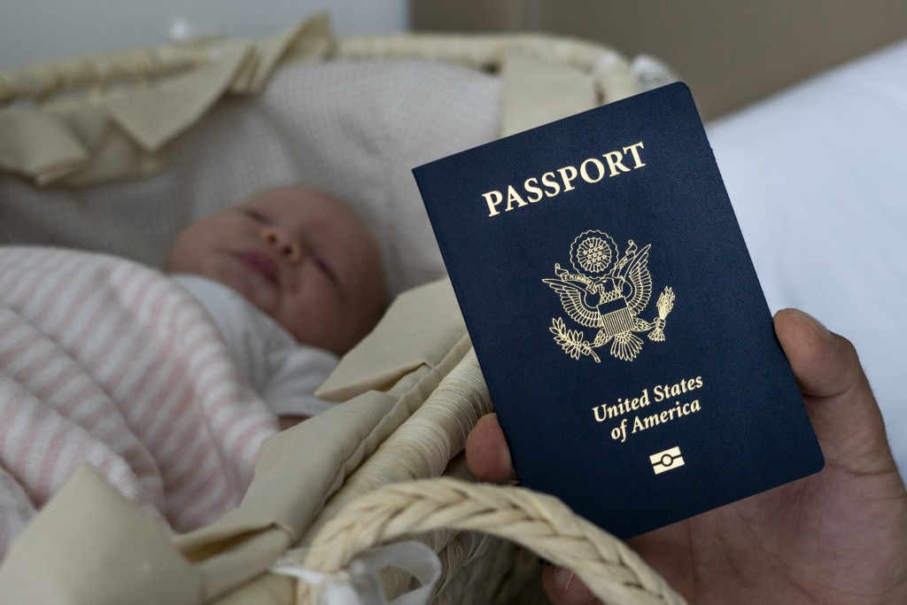 In this photo taken on Jan. 24, 2019, Denis Wolok, the father of 1-month-old Eva's father, shows the child's U.S. passport during an interview with Th...