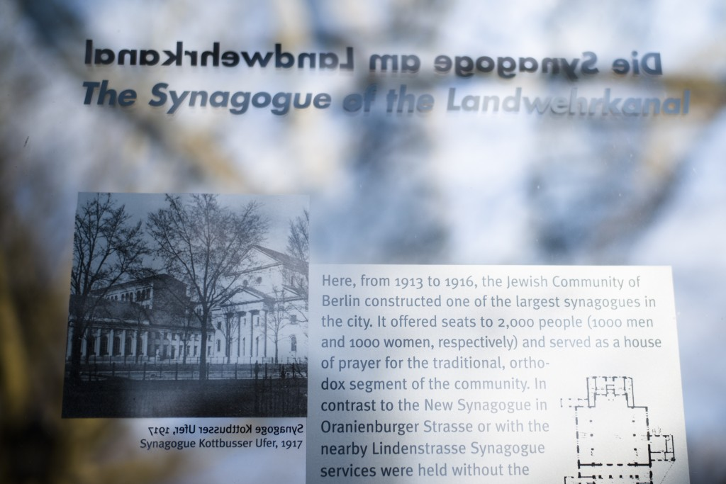In this Wednesday, March 20, 2019, a remembrance plague displays information and a photo of the former 'Fraenkelufer' synagogue, in Berlin, Wednesday,...