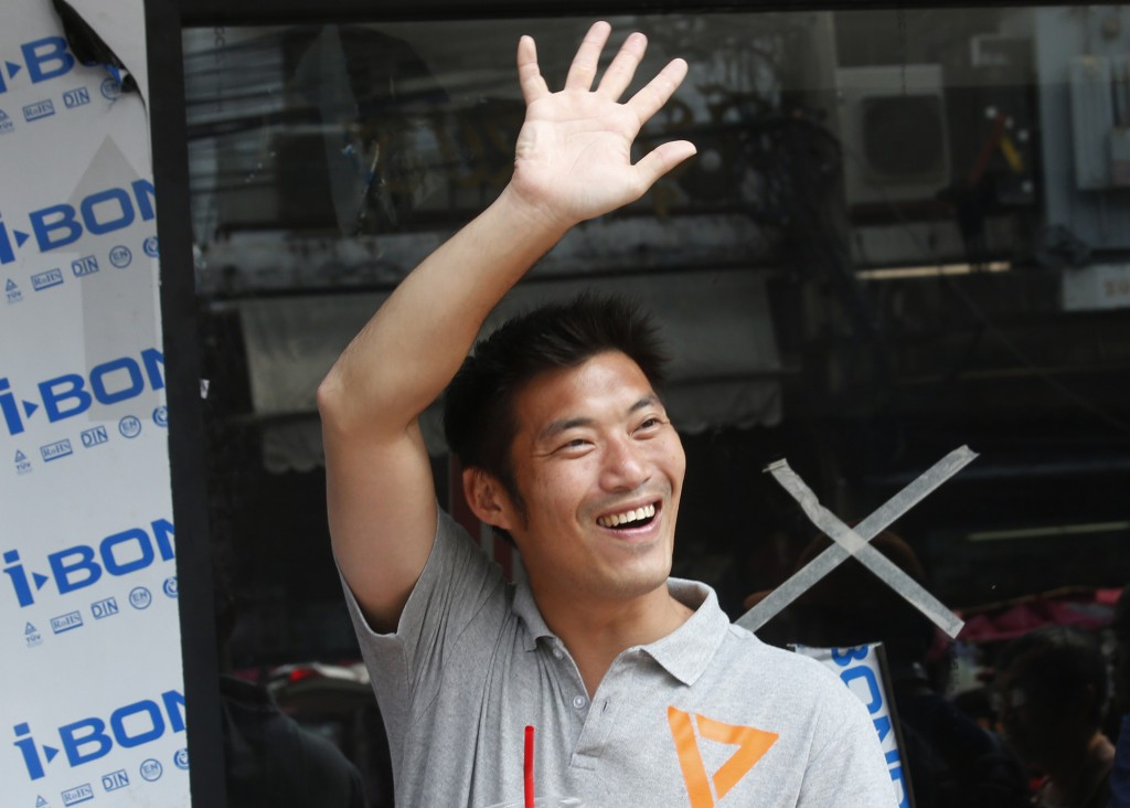 In this  March 17, 2019, photo, the leader of the Future Forward Party and candidate for prime minister Thanathorn Juangroongruangkit waves to support