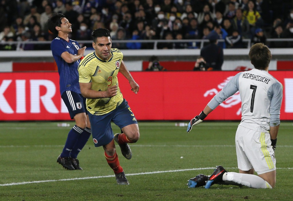 Colombia's Radamel Falcao shoots a penalty kick to score a goalduring a friendly soccer match between Japan and Colombia in Yokohama, Japan, Friday, M...