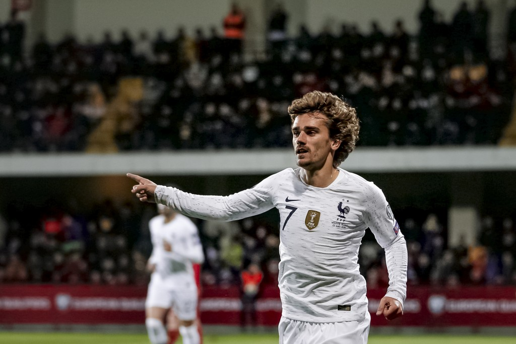 France's Antoine Griezmann celebrates after scoring a goal during the Euro 2020 group H qualifying soccer match between Moldova and France at Zimbru s...