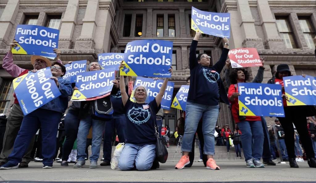 In this March 11, 2019, photo, Educators attend a rally to support funding for public schools at the state Capitol in Austin, Texas. Cost-cutting stat...