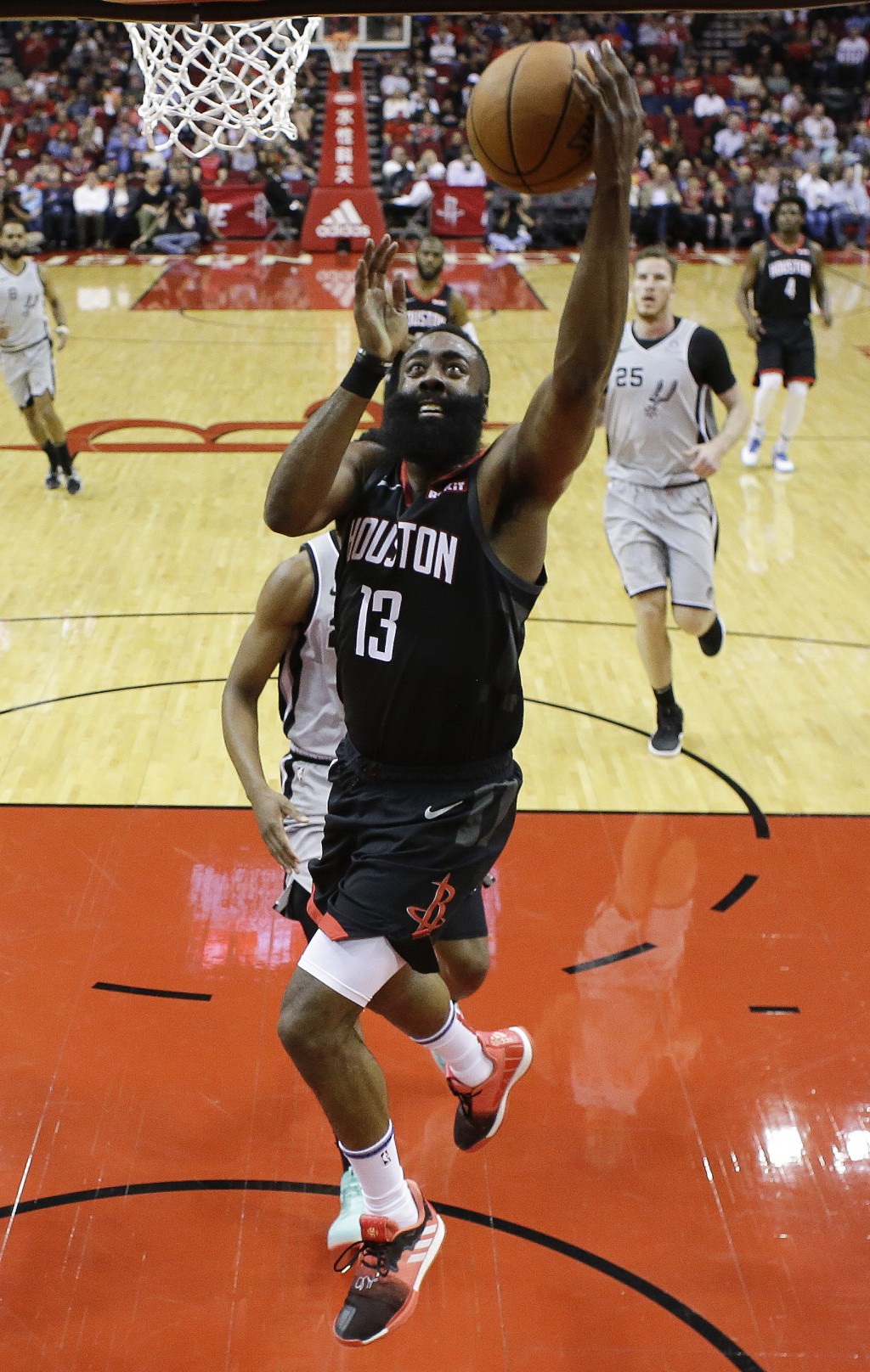 302313697456 Houston Rockets guard James Harden drives to the basket during the first  half of the team s