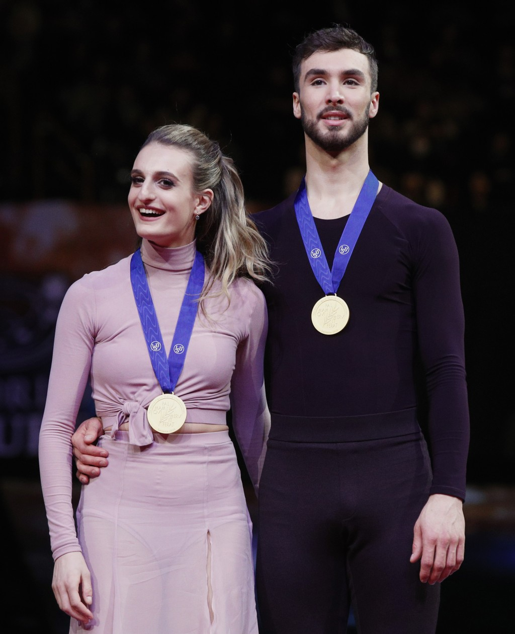 Gabriella Papadakis and Guillaume Cizeron of France stand with their medals after winning the gold for the ice dance free dance during the ISU World F