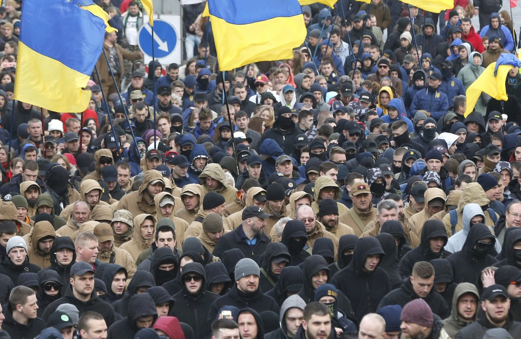 Holding Ukrainian state flags, members of far-right groups hold a mass demonstration against government corruption on the Independence Square in Kiev,