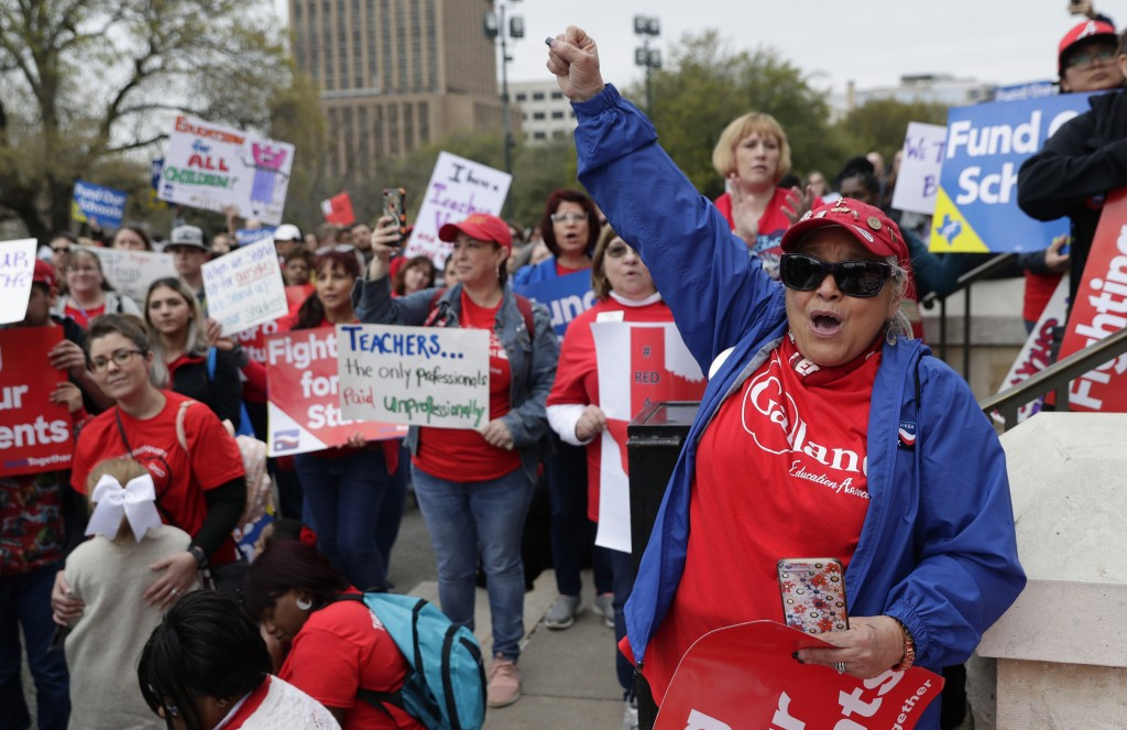 In this March 11, 2019, photo, Koni Kaiwi, right, of Garland, Texas, joins other educators during a rally to support funding for public schools in Tex...