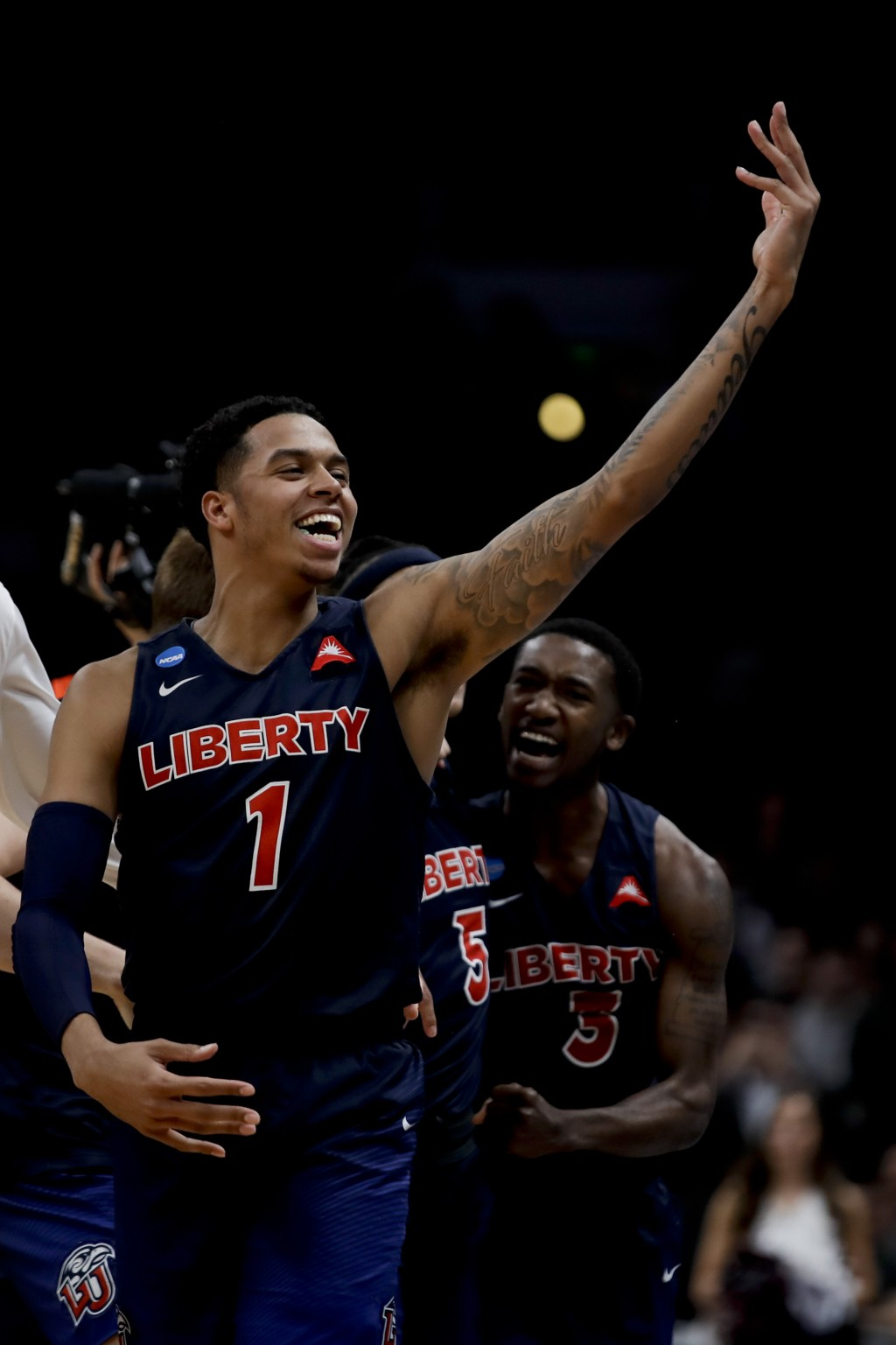 Liberty guard Caleb Homesley celebrates after the team's win against Mississippi State in a first-round game in the NCAA men's college basketball tour