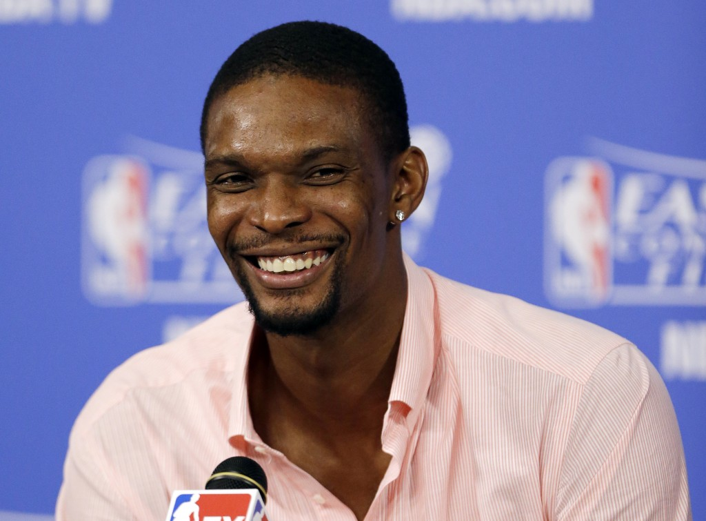 FILE - In this May 27, 2014, file photo, Miami Heat center Chris Bosh smiles during a post-game news conference after Game 4 in the NBA basketball Eas...