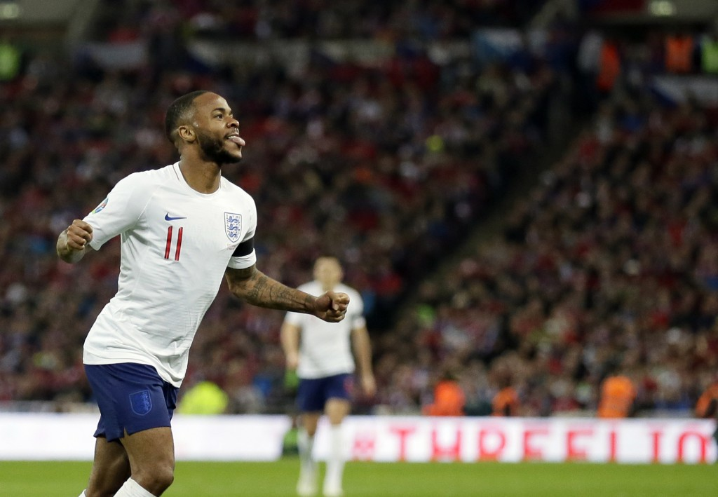 England's Raheem Sterling celebrates after scoring his side's fourth goal during the Euro 2020 group A qualifying soccer match between England and the...