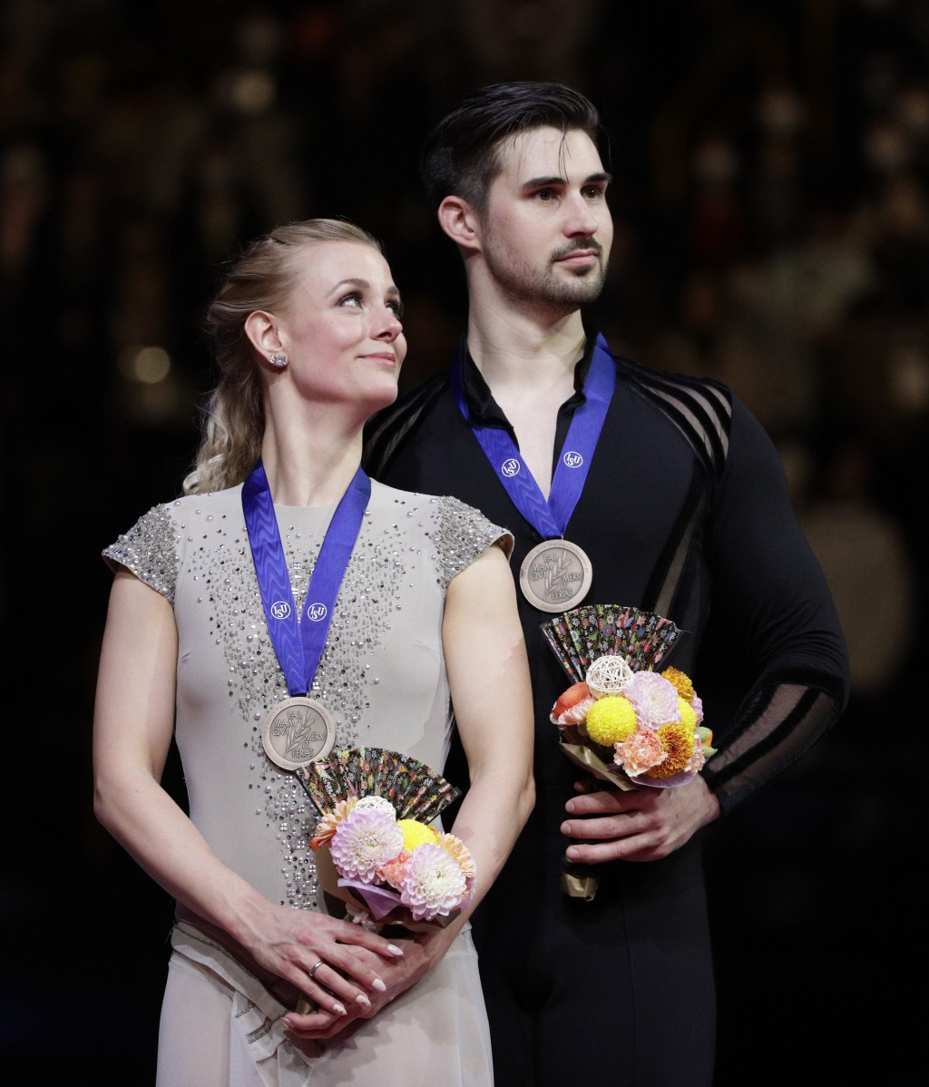 Madison Hubbell and Zachary Donohue of the U.S. stand after winning the bronze medals for the ice dance free dance during the ISU World Figure Skating