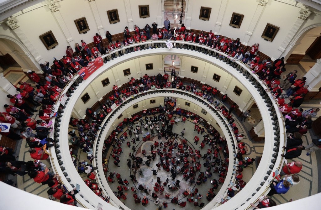 In this March 11, 2019, photo, Educators attending a rally to support funding for public schools in Texas fill the rotunda of the state Capitol in Aus...