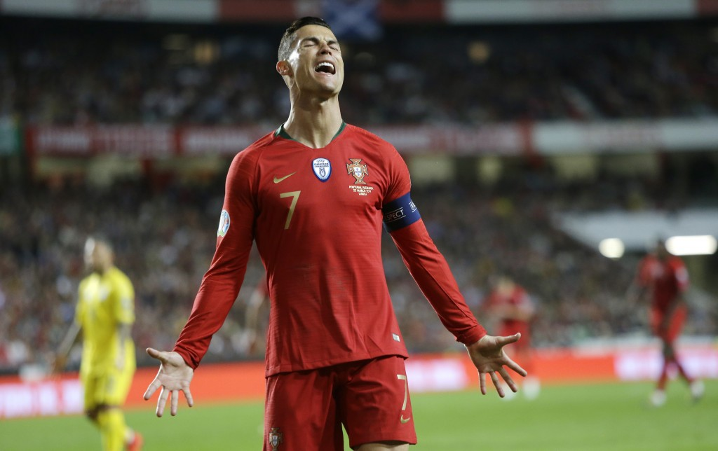 Portugal's Cristiano Ronaldo reacts after missing a scoring chance during the Euro 2020 group B qualifying soccer match between Portugal and Ukraine a...