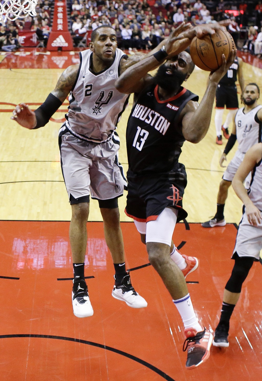 9b82e0389c1b Houston Rockets guard James Harden (13) drives to the basket as San Antonio  Spurs