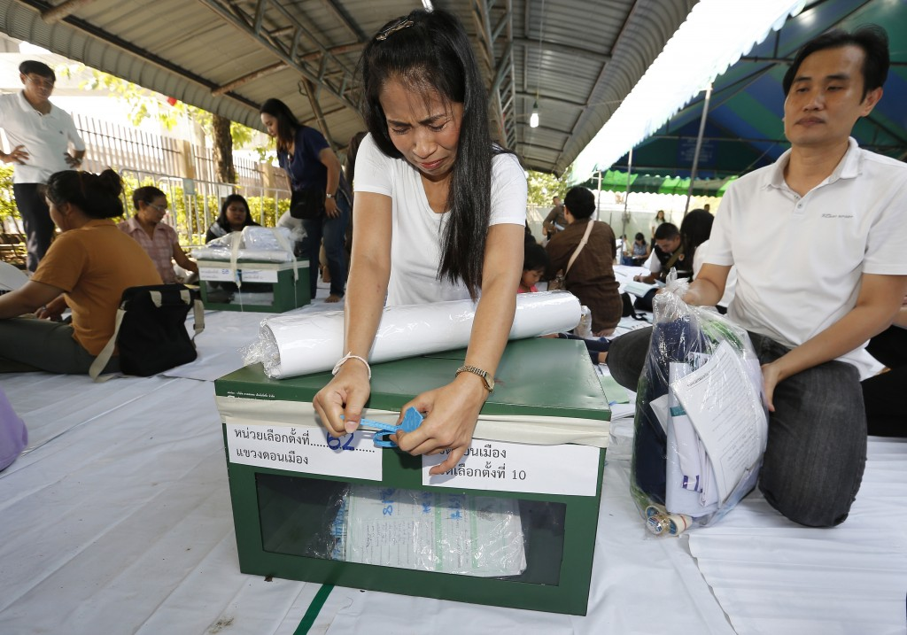 Volunteers lock ballot boxes ahead of Sunday's general elections Bangkok, Thailand, Saturday, March 23, 2019. The nation's first general election sinc