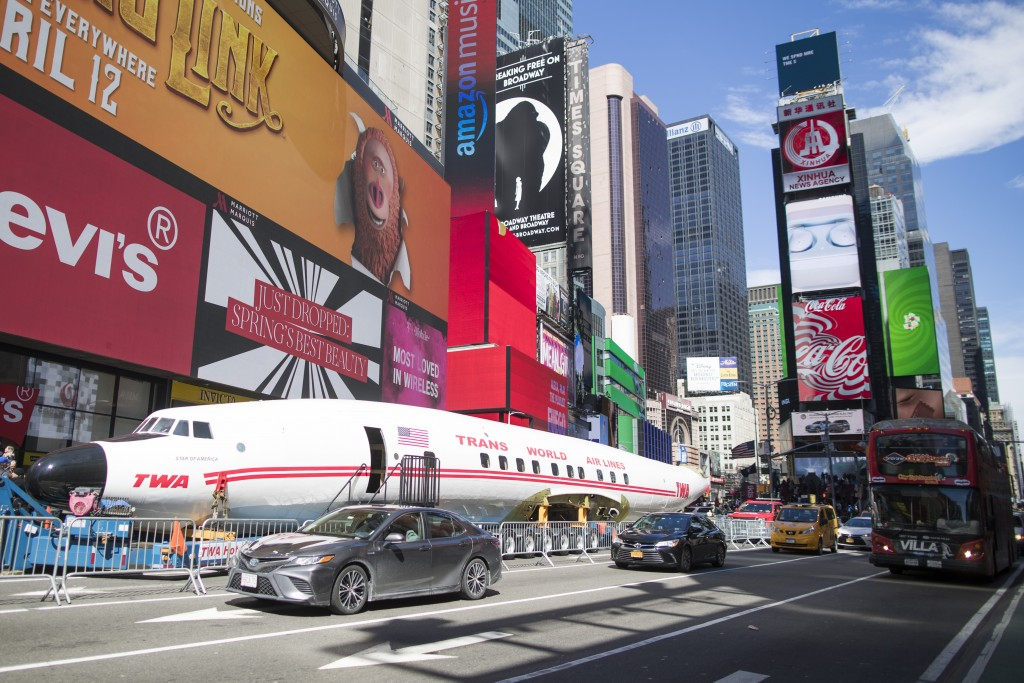"A Lockheed Constellation L-1649A Starliner, known as the ""Connie, is parked in New York's Times Square during a promotional event, Saturday, March 23,"