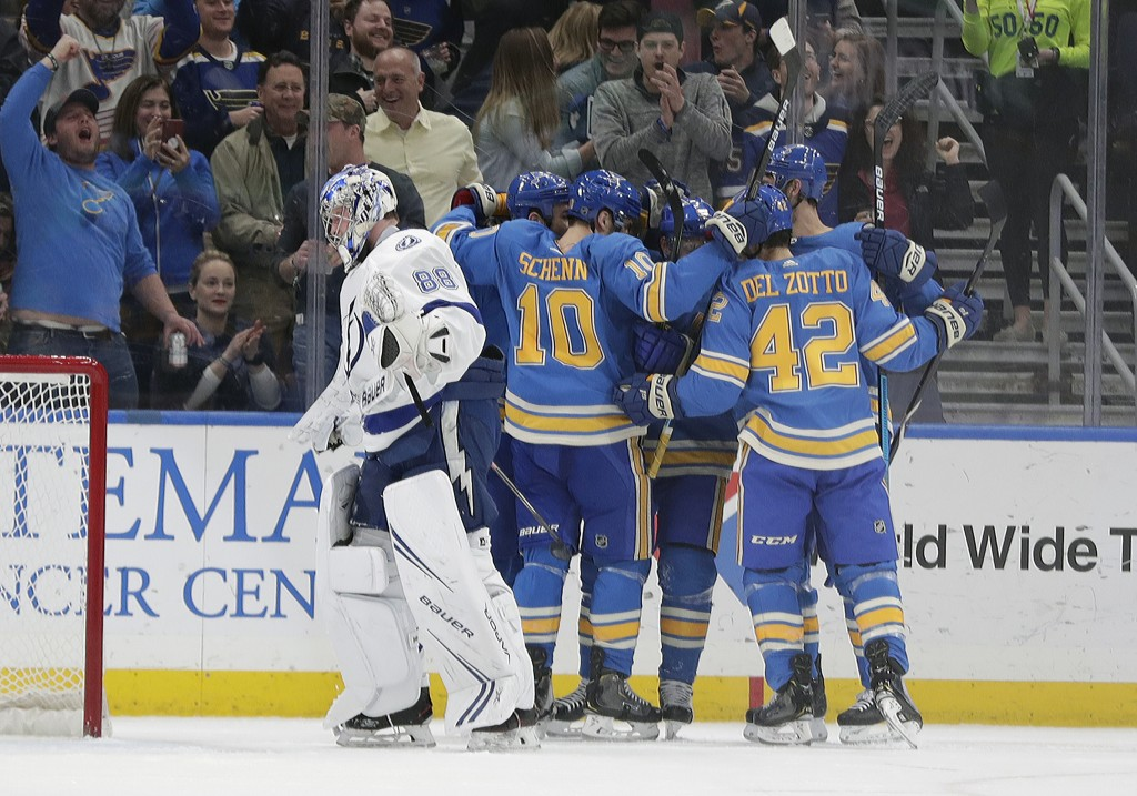 St. Louis Blues' Brayden Schenn (10) and Michael Del Zotto (42) celebrate with teammates after a goal by Vladimir Tarasenko (91) as Tampa Bay Lightnin