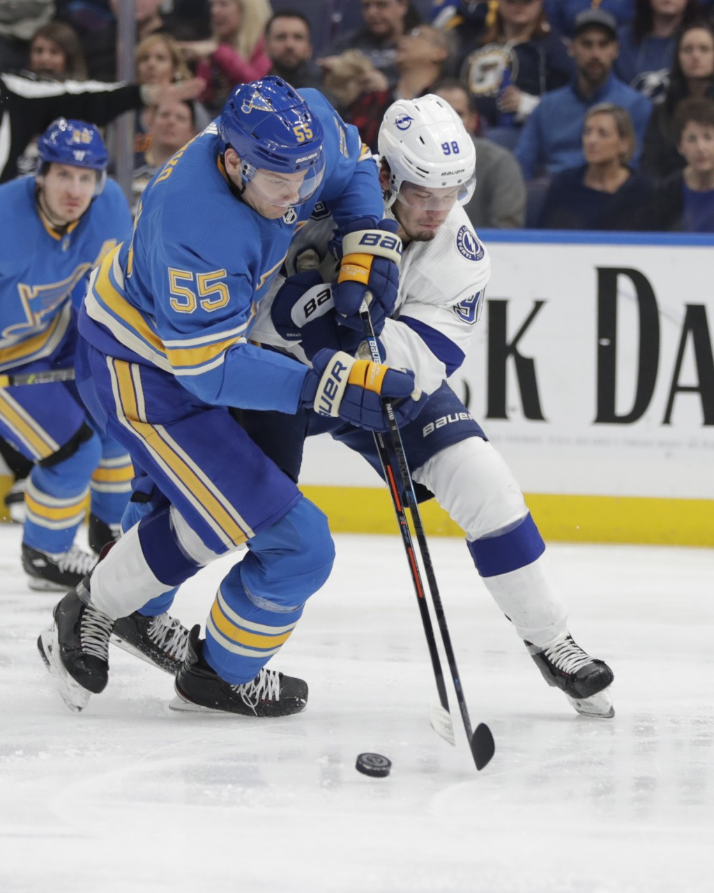St. Louis Blues' Colton Parayko (55) battles Tampa Bay Lightning's Mikhail Sergachev (98) for the puck in the second period of an NHL hockey game, Sat