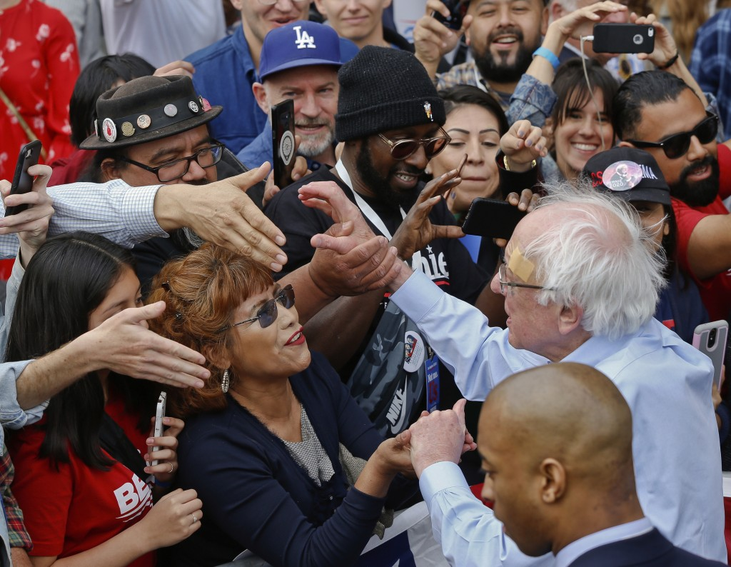 Democratic presidential candidate Sen. Bernie Sanders, I-Vt., greets supporters at a rally at Grand Park in Los Angeles, Saturday, March 23, 2019. The