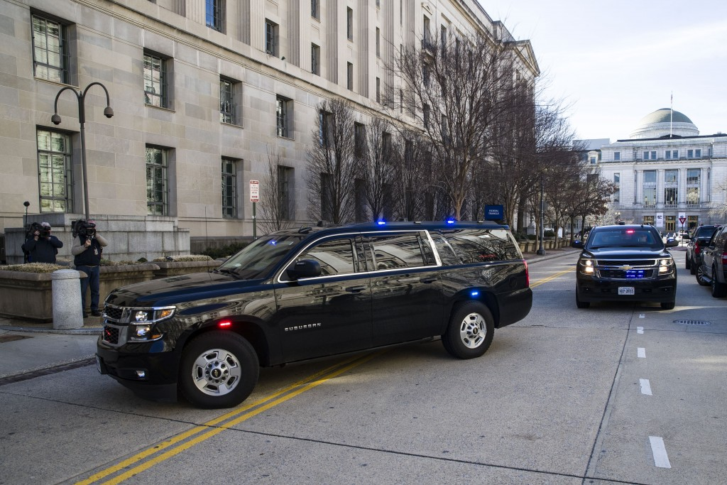 The motorcade for Attorney General William Barr arrives at the Department of Justice, Sunday, March 24, 2019, in Washington. Barr was expected to rele