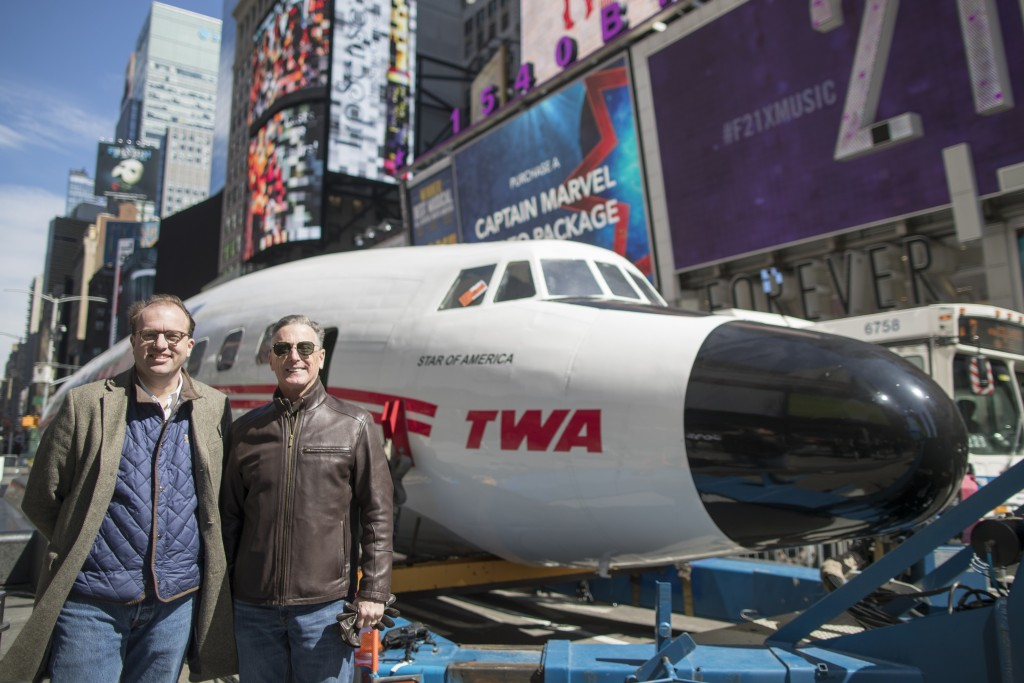 CEO and Managing Partner of MCR Tyler Morse, left, and Hotel Trades Council President Peter Ward pose for a photo next to a Lockheed Constellation L-1